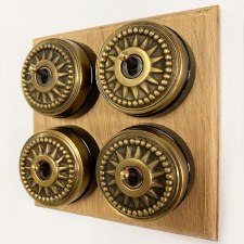 Star Round Dolly Light Switch on Wooden Base Antique Satin Brass 4 Gang