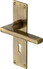 Heritage Trident Door Lock Handles TRI1300 Antique Brass Lacquered