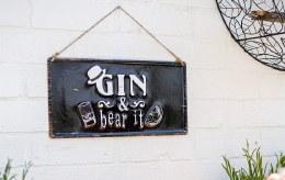 "La Hacienda Embossed Steel Sign ""Gin & bear it"""