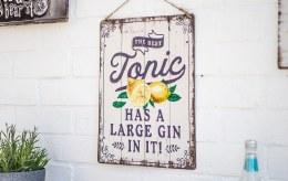 "La Hacienda Embossed Steel Sign ""The Best Tonic Has A Large Jin in It"""