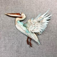 """16"""" Distressed White and Aqua Capiz With Metal Flying Pelican Wall Plaque"""