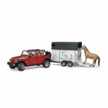 Jeep Wrangler avec van et un cheval