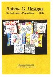 Six Embroidery Pincushions
