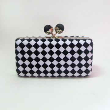 Sondra Roberts Black and White Woven Clutch