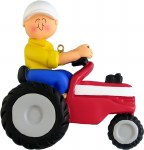 CHILD RIDING RED TRACTOR