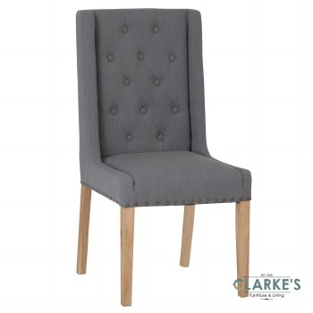 Timeless buttoned grey dining chair