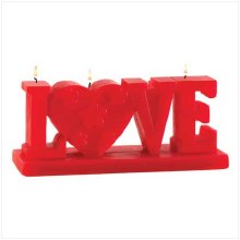 'LOVE' FIGURAL CANDLE