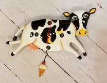 Black and white cow clock with ice cream pendulum