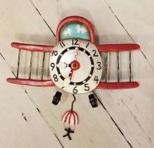 Airplane clock with man pendulum
