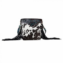 Black leather hand tooled cowhide bag with teal detail.