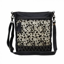Black spot print hairon leather design with front and back zipper.