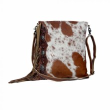 Cowhide and leather Tote with side conch and fringe