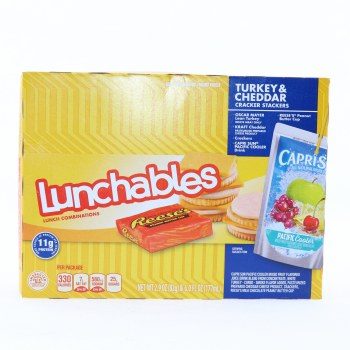 Lunchables Turkey & Cheddar Cracker Stackers. Oscar Mayer Turkey. Kraft Cheddar. Crackers. Capri Sun Pacific Cooler Drink. Reese's Peanut Butter Cup.  2.9 oz