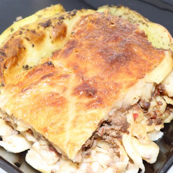 Harvestimes Home Made Greek Pastitsio Meal made with Ground Beef Onions Pasta and Bechamel Sauce