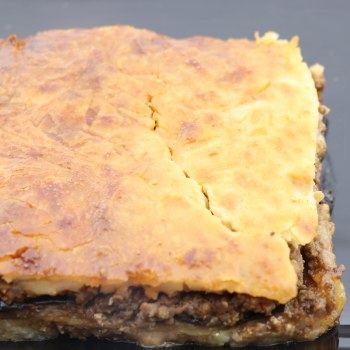 Harvestimes Home Made Greek Mousaka made with Ground Beef Egglant Potato Onions Flour Milk Eggs and Spices