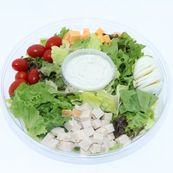 Home Made Chef Salad with Romaine Lettuce Cherry Tomatoes Cheddar Cheese Turkey or Ham Eggs and Salad Dressing