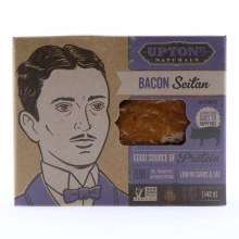 Upton Bacon Seitan in Strips Good Source of Protein Zero Oil Trans Fat  and  Cholesterol Low in Carbs  and  Fat NON GMO 8 oz