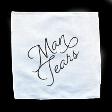 Man Tears Handkerchief