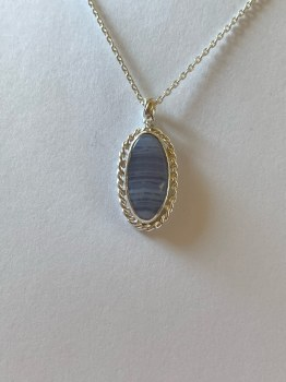"Blue Lace Agate Bezel set pendant on 18"" sterling silver cable chain with a lobster clasp"