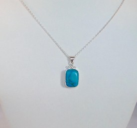 Natural Antique cushion cut turquoise stone set in a handmade sterling silver pendant