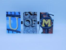 "Frame Clip ""U of M"" Frame Measures 13"" x 6"" w/ 4x6 Photos"