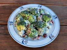 Fresh broccoli dressed with mayonnaise, dried cranberries, sunflower seeds, pepitas, and red wine vinegar.