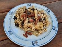 Pasta salad dressed with a basil pesto.