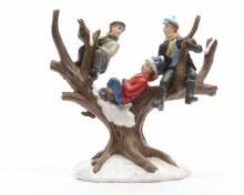 children climbing in a tree