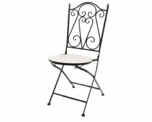iron chair with stone mosaic