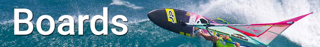 Windsurfer riding his board practically inverted on the crest of a wave!
