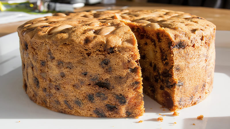 The humble fruit cake is a no no for Dogs.