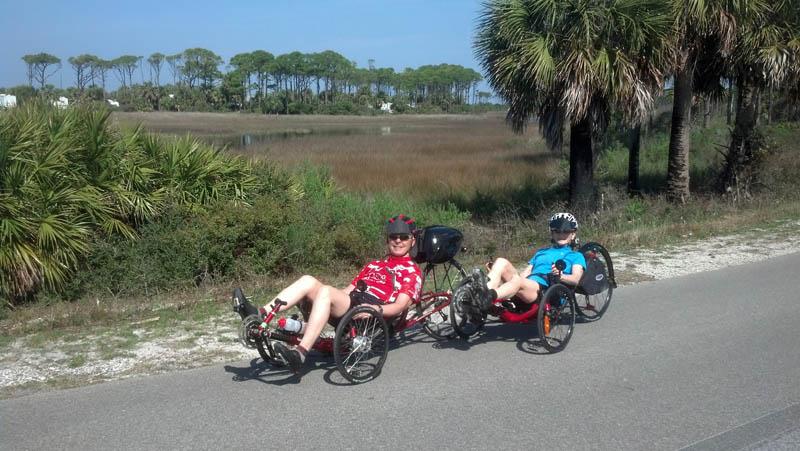 Rolf and Barb riding trikes near Port St. Joe, FL.