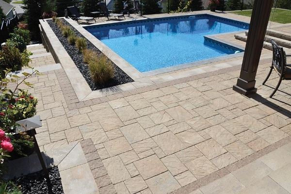 Brick Pavers by Oaks around a pool
