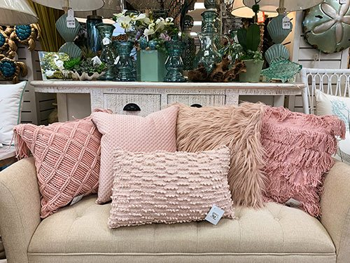 couch with pink pastel pillows