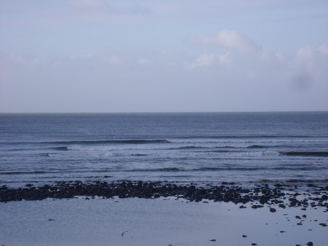 Small waves directly in front of the shop at low tide