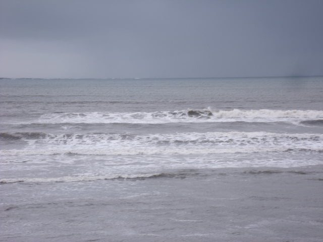 waves in front of Lahinch Surf Shop
